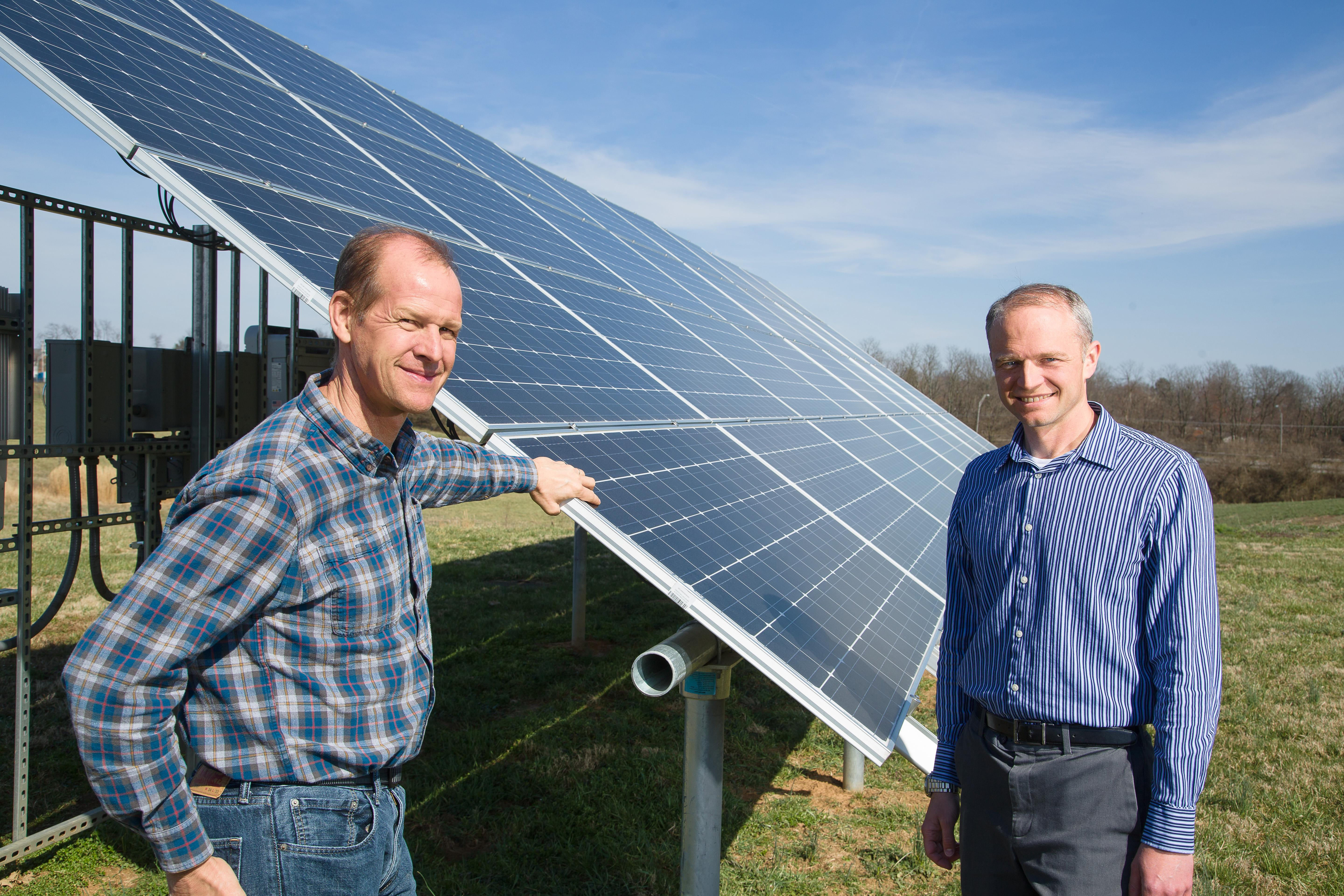 Mark Williams and Joe Dvorak with the solar array that offsets all the energy used on the UK organic farm.
