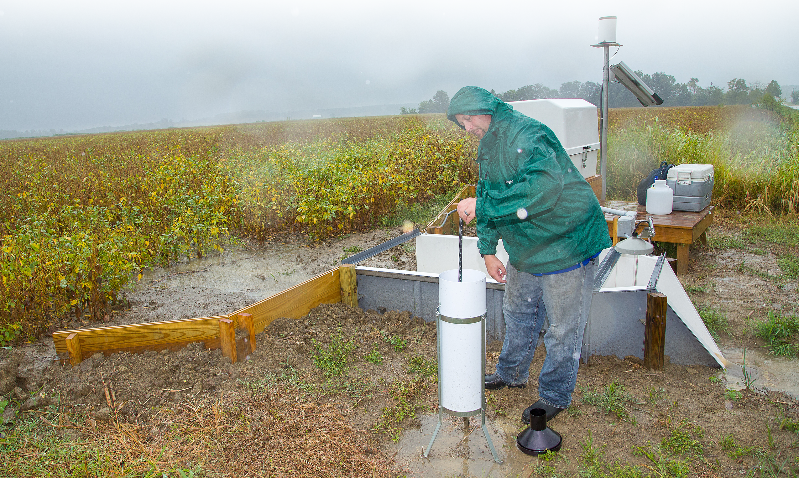 Mark Akland measuring run-off during a rain event.